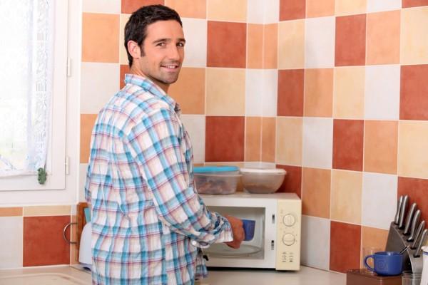 Man cooking food in microwave